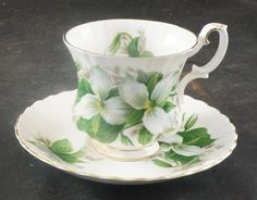 The Rare Bird is Pleased to Offer this Fine Bone China Demitasse Cup and Saucer made by Royal Albert This Set is in the Trillium Pattern. This Set is in excellent condition with No Damage. No Chips and No Cracks