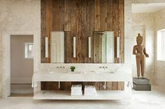 Vintage wooden accent wall in the soothing, rustic bathroom - Decoist