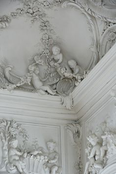 Cherubs and intricate wall, ceiling, and molding design.