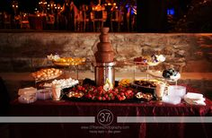 Chocolate fondue dessert station at a wedding - mmm, yum!