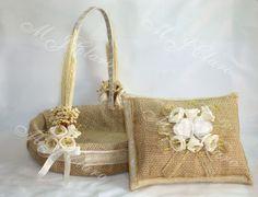 Image from http://mlb-s2-p.mlstatic.com/cesta-florista-almofada-aliancas-em-juta-decoraco-rustica-14410-MLB3293402938_102012-F.jpg.