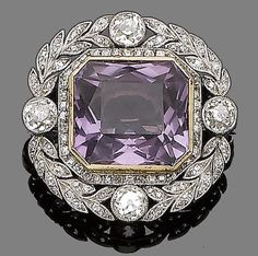 A belle époque amethyst and diamond brooch/pendant, circa 1910