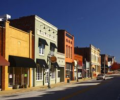 """Ram Cat Alley is part of historic downtown Seneca. The Alley got its unusual name because of the many cats who gathered around its meat and fish markets in the early 1900s. Locals used to say there were so many of them, """"you couldn't ram another cat into the alley!"""""""