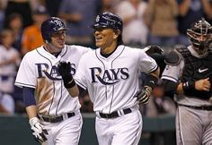 Tampa Bay Rays' Hideki Matsui, center, of Japan, is congratulated by teammate Matt Joyce after hitting a two-run home run during the fifth inning of a baseball game as Chicago White Sox catcher A.J. Pierzynski looks on, Tuesday, May 29, 2012, in St. Petersburg, Fla. (Mike Carlson/AP Photo)