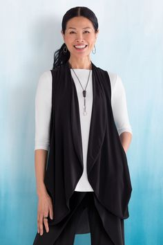 Oversized draped pockets create a flowing shape in an open-front vest with a curved hem—a perfect layering piece in smooth and supple matte jersey. Class Act Vest by Sympli. Knit Vest available at www.artfulhome.com
