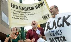 """'We need co-conspirators, not allies': How white Americans can fight racism. """"Some white people are sitting on the sidelines out of deep discomfort, confusion, and fear of making faux pas – but getting past that anxiety is a first step to help defeat injustice."""" Here: White people participate in a march on Tuesday organised by the Syracuse Peace Council to protest against racism and the murders of nine people in a black church in Charleston, South Carolina."""