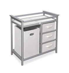 Badger basket's modern changing table keeps everything tidy and concealed for a clean look in the nursery.