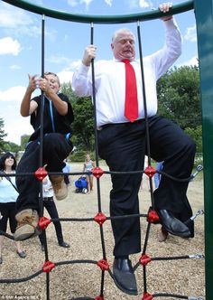 Toronto Mayor Rob Ford climbs a rope ladder at the opening of the T-Rex themed playground . Rob Ford, Rope Ladder, T Rex, Fun Workouts, Playground, Toronto, Lol, People, Children Playground