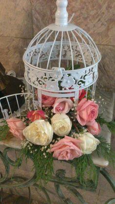 Jaula con flores