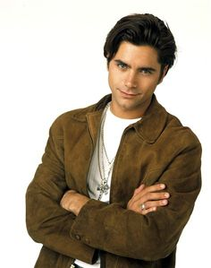 "John StamosThis attractive actor spent most of the '80s working on television, but it wasn't until 1987, when he won the role of Uncle Jesse in ""Full House,"" that he became a household name. After the show went off the air in 1995, John appeared in a series of made-for-TV movies. In 1998, he became half of one of the sexiest power couples in Hollywood when he wed Rebecca Romijn.RELATED: Hollywood's hottest hunks of yesteryear"