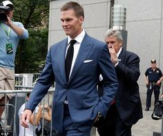 Looking pleased: Tom Brady had a smile on his face as he left court on Monday; on Thursdaythe New England Patriots quarterback saw his four-game ban overturned by a federal judge