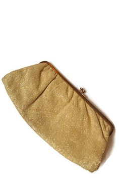 Vintage Clutch Purse Satin Shimmer Gold  (Clutch) from the 1960s. $15.00, via Etsy.