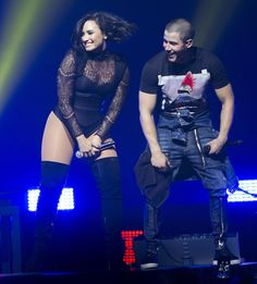 Demi Lovato bares her bottom in a lace bodysuit and thigh high boots at the Barclays Center in Brooklyn for her Future Now Tour on July 8, 2016.