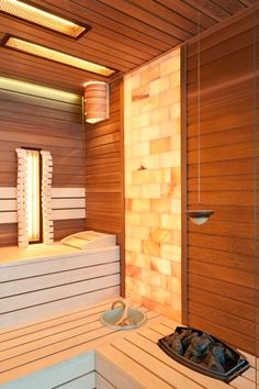 The greatness and beauty of the custom-designed combined sauna come from simple streamline and the large glass surface.