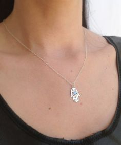 Sterling silver necklace with sterling silver hamsa pendant and 4mm opal stone. Necklace Measures Approximately 17 Hamsa pendant- 20 mm Please