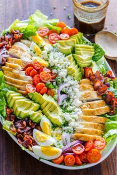 Easy Chicken Cobb Salad with the Best Cobb Salad Dressing! A protein-packed salad loaded with crisp lettuce, tomatoes, chicken, avocado and blue cheese. Cobb Salad with the Best Dressing (VIDEO) - Natasha Ensalada Cobb, Cobb Salad Ingredients, Cobb Salad Dressing, Chicken Salad Dressing, Party Food Platters, Cheese Platters, Avocado Chicken Salad, Chicken Salads, Taco Salads