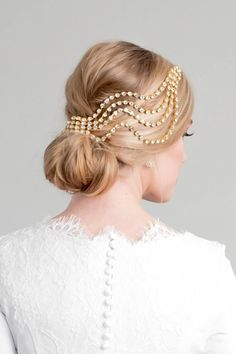 Ripple Headpiece - Style #201 Cascading ripples drape gently across your hairline to create a soft yet bold statement. Each strand of crystal is hand wired for stability and flexibility. This piece is created several combinations of crystal and pearl for a touch of glamour and elegance that will coordinate perfectly with your ensamble. > Available in silver or gold with the option of alternating pearls and crystals, all pearl, or all crystal. Also available in gold with opaque ivory jewel...