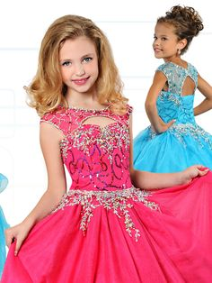 A fabulous girls pageant dress by Ritzee Girls with the perfect amount of glitz to steal the scene. This tulle Ritzee Girls pageant dress 7129 features a sheer illusion neckline with cap sleeves, sweetheart beaded bodice with small cutout, and a ball gown skirt. You can get a good fit with the lace up back. Features: Cap Sleeves Silhouette: Ball Gown  Neckline: Jewel Neckline  Fabric: Shiny Soft Tulle/Sequins Tulle Sizes Available: 2 through 14   Colors Available: Fuchsia, Turquoise and…