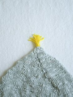Tassel: Tiny AttachedTassel - Knitting Tutorials: Finishing Techniques - Knitting Crochet Sewing Embroidery Crafts Patterns and Ideas!