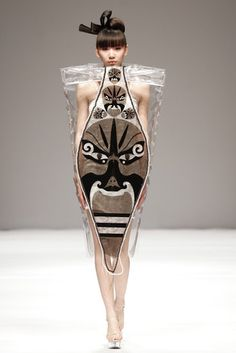 Sculptural fashion - clear plastic dress with tribal mask print; wearable art // Beijing Fashion Week A/W 2013