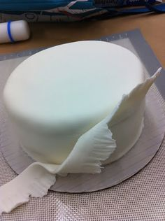 how to make a ruffle cake with fondant. This is where i use my new tool for ruffles - cutout!  This looks so easy to do love the drama of the flower