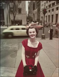 Lady in a red dress, New York City, 1950s. 50s found photo print ad street day #NewYorkScene