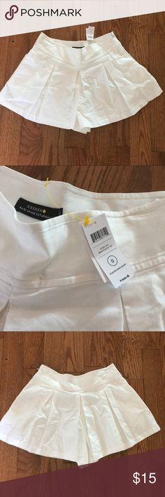 NWT Kate Spade Saturday White Skort!!!! Size 0 This is a brand new with tags Kate Spade Saturday Size 0 White Skort!!!! Super cute and looks just like a skirt!! Can be dressed up or down! Please feel free to make offers or bundle deals! Happy to negotiate!! kate spade Skirts Mini