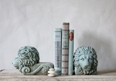 Set of Two Turquoise Stone Lion WIndow Props. $75.00, via Etsy.