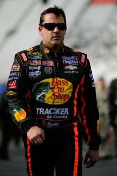 Tony Stewart, driver of the #14 Bass Pro Shops / Mobil 1 Chevrolet, walks on the grid during qualifying for the NASCAR Sprint Cup Series Food City 500 at Bristol Motor Speedway on March 14, 2014 in Bristol, Tennessee.  http://www.pinterest.com/jr88rules/nascar-2014/