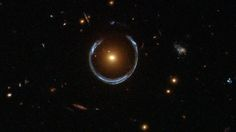 Gravitational lensing turns a galaxy into an Einstein Ring.