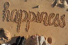 My happiness begins and ends here as it is written in the sand.