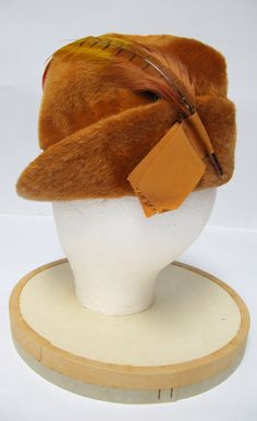 1950's Orange Felt Fur with Ribbon and Feathers Hunting Cap. $60.00, via Etsy.