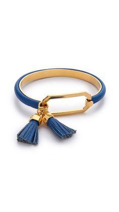 Tory Burch tassel bracelet.