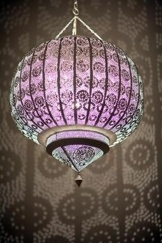 Moroccan punched metal lamp.  Would look great in my bedroom!