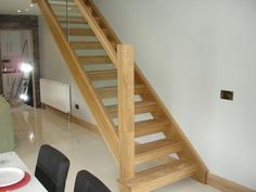 White oak staircase with open risers and glass balustrade in Letterkenny, Co. Donegal, Ireland.
