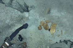 shipwreck site of the SS Central America. Odyssey photo of coins and nuggets