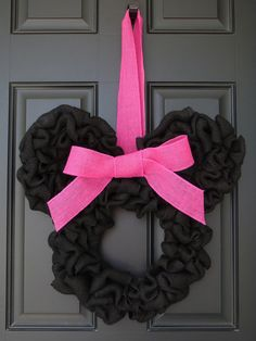 Disney inspired decorative burlap door wreath. Each wreath is handmade to order and measures approximately 21 inches wide and 20 inches in length.