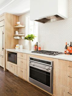Mini subway tiles create a modern twist. 22 Kitchen Backsplash Ideas.