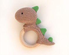 Crochet Dinosaur Patterns, Crochet Patterns Amigurumi, Crochet Baby Toys, Crochet Animals, Crochet Supplies, Baby Rattle, Amigurumi Toys, Handmade Toys, Etsy Handmade