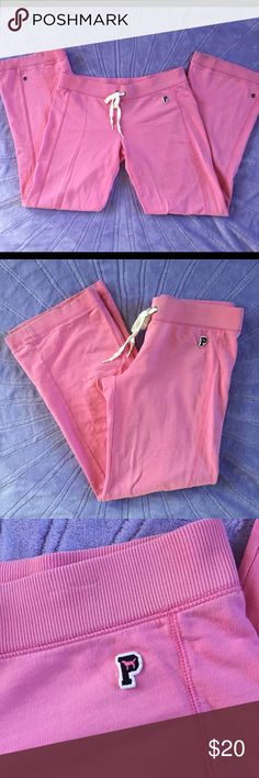 """Victoria's Secret Pink Brand sweat pants Small GUC. Pink brand pink sweat pants. Minimal signs of wear. There is some wear to the hems of the legs from dragging (no holes or rips- some discoloration- see pics). Small amount of pilling/wear in the crotch. The rest is great! Small logo on the front and screen print """"Love Pink"""" on the back. The legs are decorated with metal hardware. Elastic waistband and drawstring ties. PINK Pants"""
