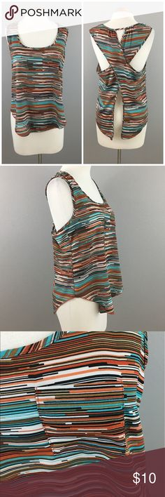 Turquoise Orange Open Back Pocket Tank Top Blouse Turquoise Orange Open Back Pocket Tank Top Blouse. Size large, please note size tag has been removed. Thank you for looking at my listing. Please feel free to comment with any questions (no trades/modeling).  •Fabric: 100% polyester  •Condition:  VGUC, no visible flaws.   25% off all Bundles or 3+ items! Reasonable offers welcome. Visit me on INSTA @reupfashions. Forever 21 Tops Tank Tops