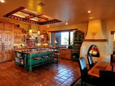 HGTV fan classicnewmexico created a warm kitchen in bold hues of green and red, but it's the tile work, wood-burning oven and natural wood accents that make this space so eye-catching.