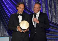 MAY 14, 2015 Honoree Alexandre Desplat (L) accepts the BMI Icon Award from BMI President and CEO Mike O'Neil during the 2015 BMI Film & Television Awards at the Beverly Wilshire Hotel on May 13, 2015 in Beverly Hills, California. (Photo by Lester Cohen/Getty Images for BMI)