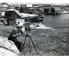 Woman with #camera at Peggy's Cove ca. 1941. #history