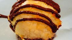 These coconut macaroons are dipped in chocolate and taste like they came from the bakery.