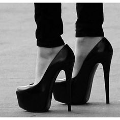 Can you see me way up here?! Classic Black Heel