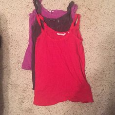 Three VS camisoles Lot of 3 camisoles. All Victoria's Secret size small NWOT. Red, purple, and grey. Victoria's Secret Tops Camisoles