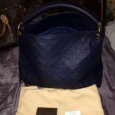 Louis Vuitton Artsy Empriente MM in Infini Authentic Louis Vuitton Artsy Empriente MM in Infini (very dark navy blue, almost black.) Excellent condition. Has been stored in its dust bag. Maybe used a handful of times. Like most, I have babied this bag. From a smoke and pet free environment. Comes with dust bag, care booklet, original tags and receipt. Additional photos to be posted soon. Serious inquiries only.   Will trade for larger Sized authentic current style LV bags. Comment if…