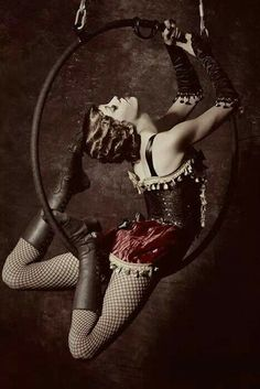 Aerial hoop performer dressed in a burlesque themed outfit. I like all the tassels!