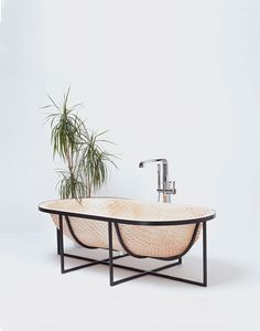 tal engel's otaku woven bathtub draws on traditional asian boat building techniques